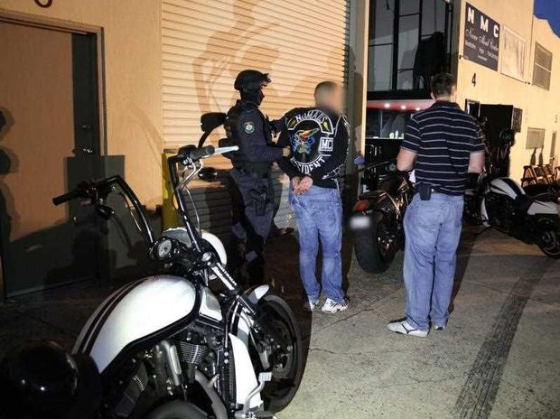 A supplied image obtained Sat. Jan. 31 2015 shows a NSW police raid on the Nomads bikie headquarters in Sydney, Friday, Jan. 30. 2015. The raid resulted in thirteen arrests.
