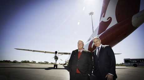 Wagners chairman John Wagner and QantasLink CEO John Gissling in front of a Qantas Q400 aircraft that will be servicing Wellcamp airport. Photo: Contributed