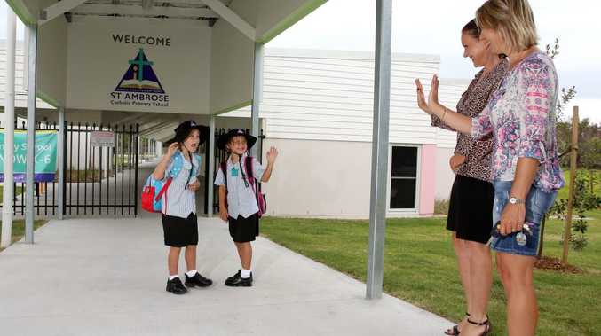 Melanie Graham and Corynne Woodger with their excited daughters Bronte and Lyla-Rose on the first day of the new St Ambrose Catholic Primary School. Photo: Nolan Verheij-Full / Tweed Daily News