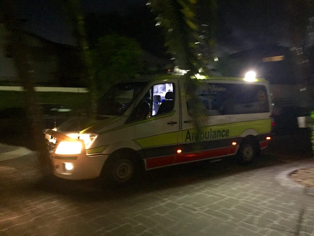 An ambulance leaves the scene of a near-drowning in Pialba on Sunday evening.