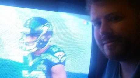 Jonathon Hogan watches the Super Bowl from his motel room.