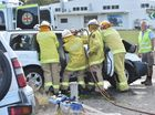 Firefighters cut a woman from the wreck of a car after a crash at the corner of Maryborough Hervey Bay Rd and Urraween Rd.