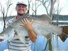 BIG BARRA: Dustin Sippel of Gooburrum holding a freshwater barra.