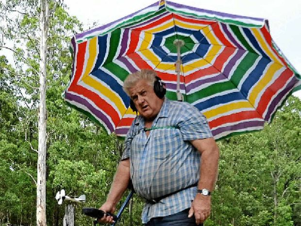 IDEAS MAN: Adrian Hastie of Coombell shows off his no-hands umbrella.