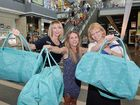 Marion van Lint (left), Amy Dargavel and Gail Hirst with free duffel bags that are on offer when you buy a $100 Caneland Central gift card.