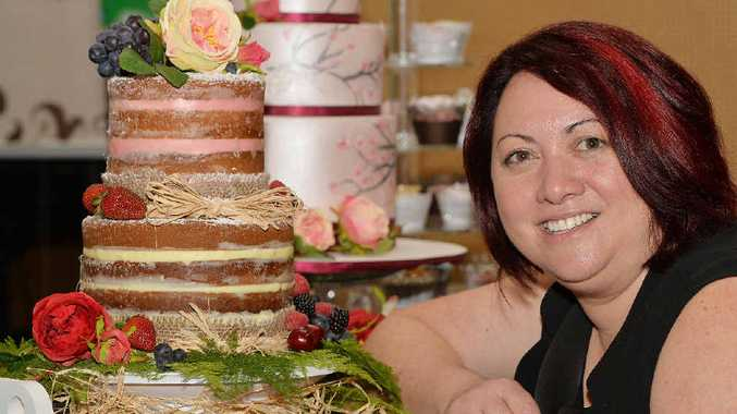 """Teena Rees-Wilson, of JR Cake Designs, displays a """"naked cake"""" at Mackay's Premier 29th Annual Bridal Fair yesterday organised Lucy Dillon for Brides and Crafty Cat."""