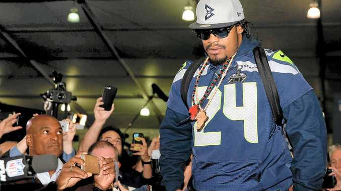 FEW WORDS: Running back Marshawn Lynch of the Seattle Seahawks arrives at a Super Bowl XLIX media conference at the Arizona Grand Hotel in Chandler, Arizona.