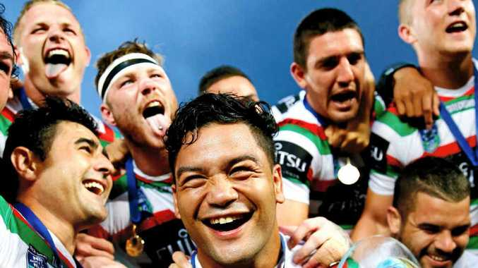 PARTY TIME: Issac Luke of the Rabbitohs celebrates with the trophy and teammates after winning the Auckland Nines.