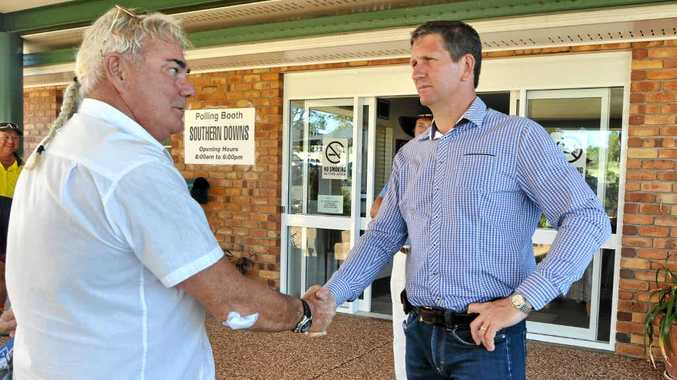 NOT OVER YET: Re-elected MP for Southern Downs Lawrence Springborg talks with voter Damian Griffin on Saturday.