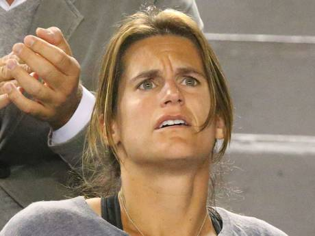 Murray's coach Amelie Mauresmo looks on in shock as Murray falters