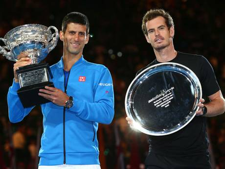 Djokovic holds his trophy next to runner-up Murray