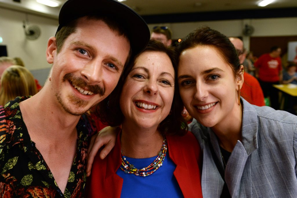 Jen Howard celebrates becoming state member for Ipswich with her children Patrick and Samantha at the Ipswich Trades Hall on Saturday night.