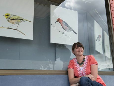 Artist Grace McClymont with her exhibition in Murray's Duggan St Gallery.