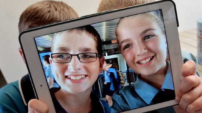Year 7 Mercy College students Cameron Wooldridge and Dana Bennett test their photographic skills.