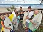 WAVES ON THE WAY: Ben Silk, of Silky Surf School, and his young charges from Wind and Sea Boardriders are pumped about the predicted rise in swell, while (inset) Aidan Feeley gets in some practise at Caloundra.