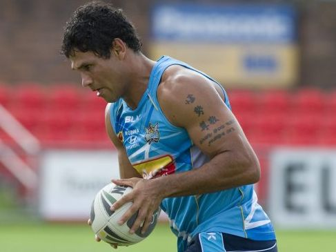 WARMING UP: Titans centre Brad Tighe trains at Clive Berghofer Stadium last year.