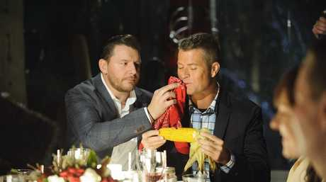 Manu Feildel and Pete Evans enjoying some of Robert and Lynzey's Texas fare.