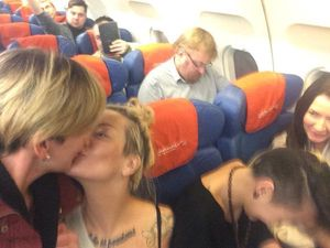 Two Russian lesbians kiss-selfie in front of anti-gay tsar