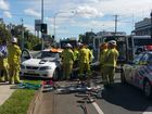 Firefighters work to free an injured person following a crash at North Ipswich Thursday morning.