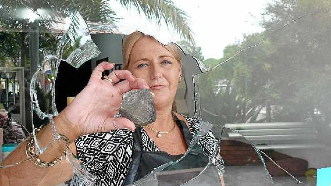 BREAKING NEWS: Owner of Styles on Prince St Janelle Cooper shows the rock vandals used to smash her front window on Sunday night. PHOTO: TIM HOWARD