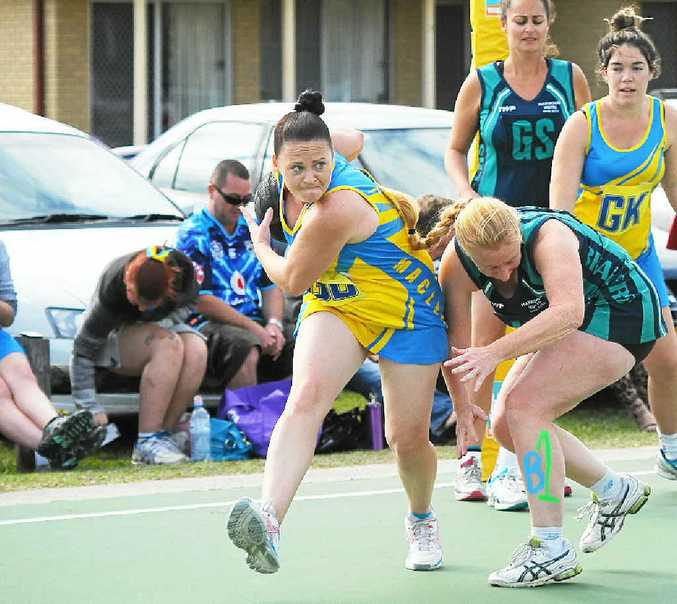 GOING HARD: Emma Marcus for Maclean Bottom Pub during the 2014 Lower Clarence A-grade netball grand final at Wherrett Park, Maclean. Lower Clarence Netball gets preparations for the 2015 season underway with junior rep trials this Tuesday. PHOTO: LEIGH JENSEN