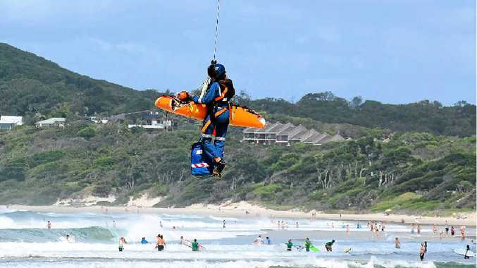 The injured surfer being airlifted from Belongil beach on Wednesday