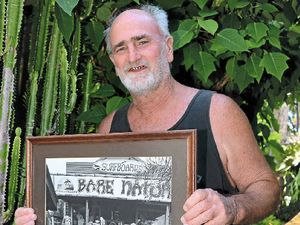 GONE SURFING: Roy Meisel, retiring after 43 years in the local surfing industry, with a picture of the original Bare Nature crew.