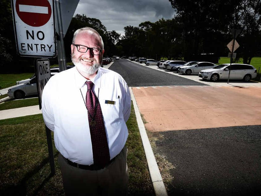 PICTURE: Trinity Catholic College principal Brother John in front of Brunswick St which the Catholic church is proposing to buy.
