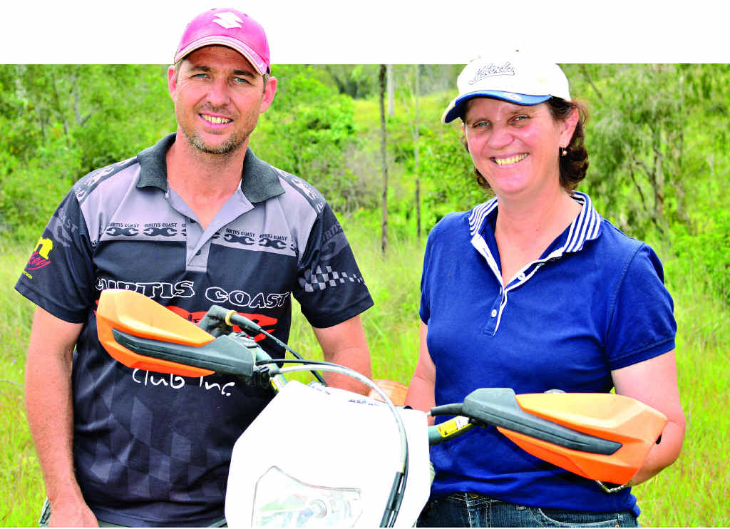 STEPPING UP: Curtis Coast Trail Riders Club member Jason Rice with Anthea Adams, who is hosting a trail riding event on her family's property to raise money for another Ambrose family, despite not having anything to do with the club previously.