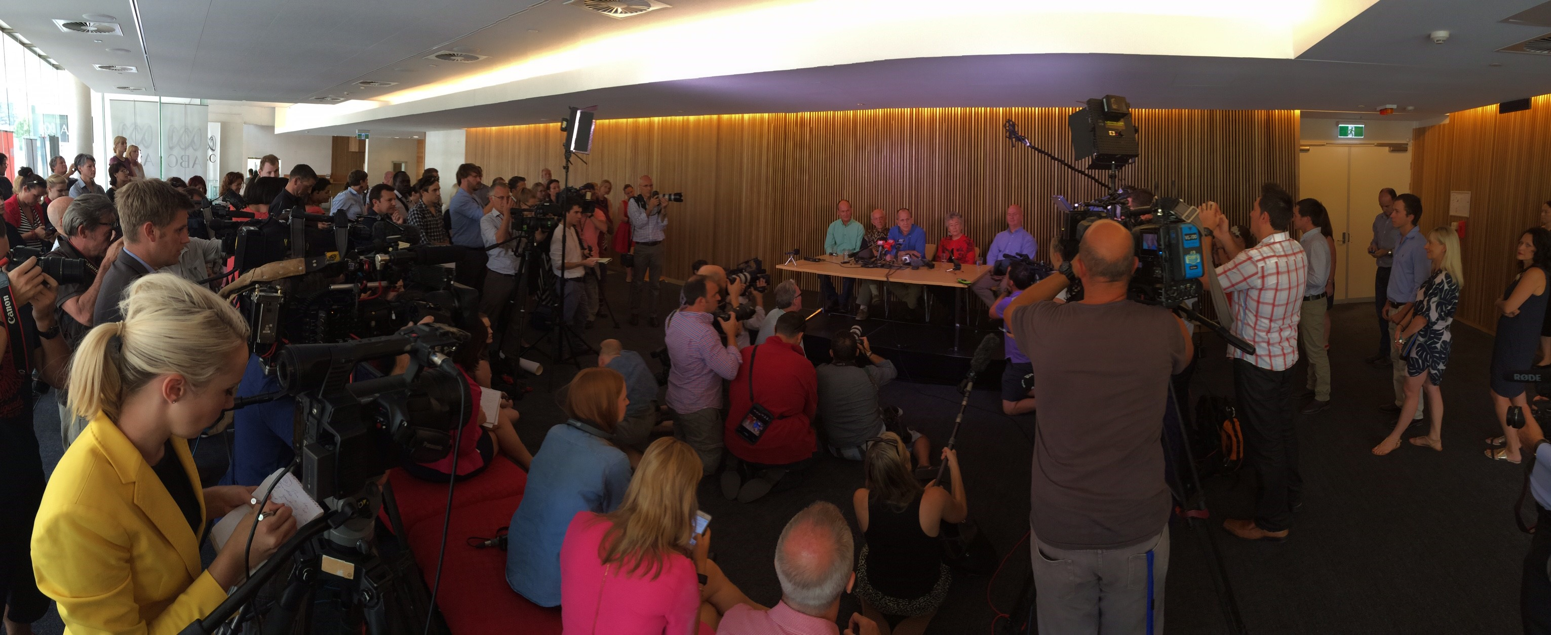 A massive media scrum surrounds freed journalist Peter Greste at his Brisbane press conference on February 5.