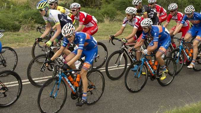 Last year's Oceania Championships men's road race field heads towards the finish at Goombungee.