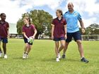 Titan players visit Toowoomba Anglican College and Preparatory School. From left Ruva Maphosa, Jamethiel Evans and Ruby Linten with Matthew White Photo Bev Lacey / The Chronicle