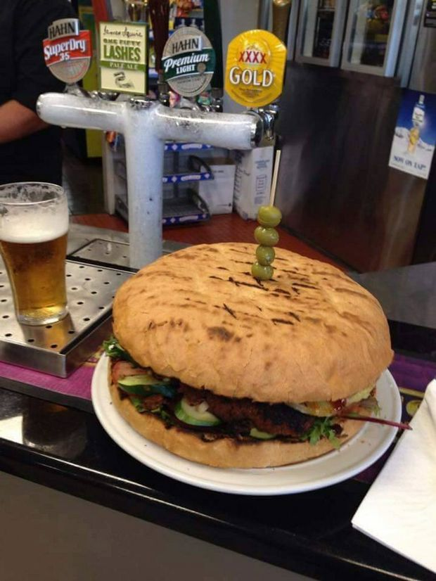 MOUTHFUL: The 1.2kg burger at the centre of the Lighthouse Hotel Motel's Beacon Burger Challenge. Photo Contributed