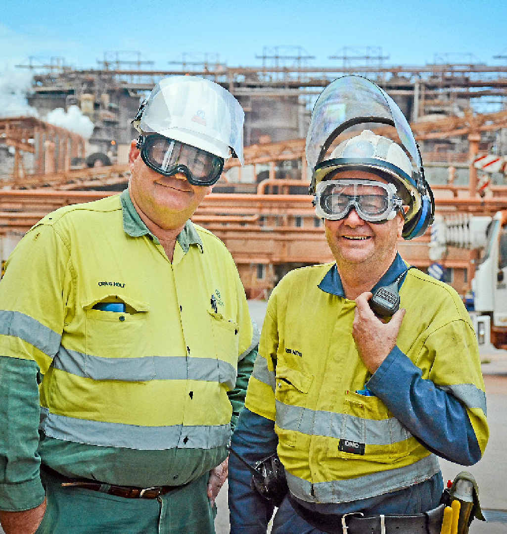 QAL PROUD: Craig Holt and Greg Meyer are two of six Queensland Alumina Ltd workers who began as apprentices 35 years ago and still work there.