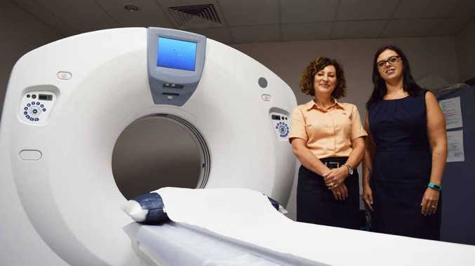 NEW TO TOWN: Norelle Comino and Jocelyn Wieser from CQMI with the new CT scanner.