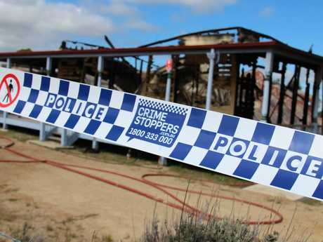Fire investigators and police crime scene investigators are working to establish a cause of the blaze which destroyed backpacker accommodation at Thulimbah.