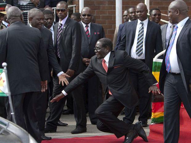 Zimbabwean President Robert Mugabe falls after addressing supporters