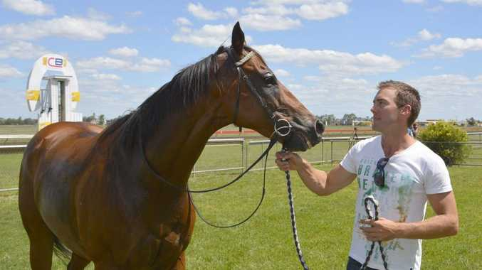 Brenton Andrew celebrates his first training success with yesterday's Dalby Cannonball winner Tornadoes.