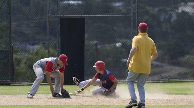 SAFE SLIDE: Rangers' Dustin Asham slides into third base against Redcliffe.