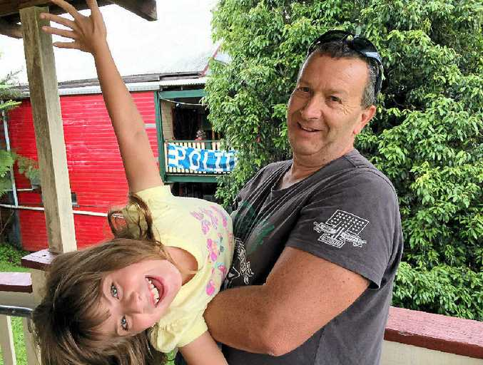 David Stevens and his eight-year-old daughter Deisha Magic-Stevens, who has been taking cannabis oil to treat chronic seizures for one year at the Nimbin medicinal cannabis workshop on Saturday. Deisha's quality of life has been vastly improved through the use of the drug.