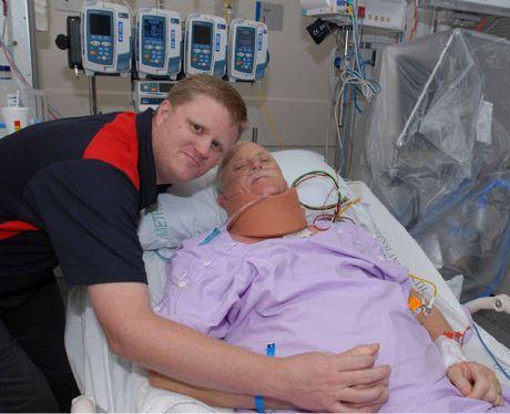 TOUGH TIME: Gordon Marsden with son Troy at Princess Alexandra Hospital, Brisbane.