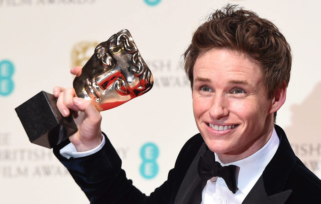 Eddie Redmayne poses with his BAFTA Award for Best Leading Actor for his performance in The Theory of Everything.