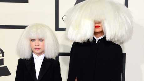 Australian singer Sia, right, and dancer Maddie Ziegler arrive for the 57th annual Grammy Awards.