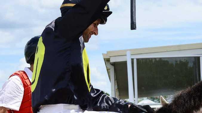 VICTORY JOY: Jockey Larry Cassidy enjoys his winning ride aboard Omnibus Christus at Ipswich racetrack.
