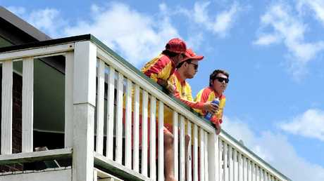 Ballina surf lifesavers watch the water for any sign of the shark during the ongoing operation.