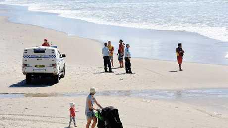 Police and beach goers share Shelly Beach.