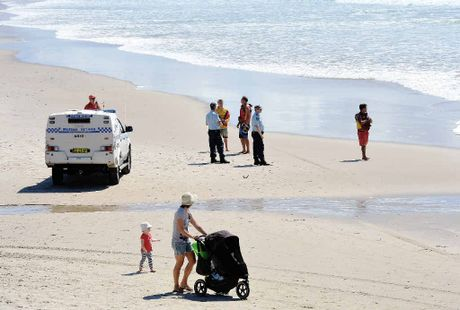 Police and beach goers share Shelly Beach.