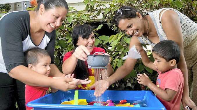 BUSY HANDS: Flor and Ernesto Valencia, 2, Playgroup Queensland Gladstone's Debbie Flaherty and Sneha and Vivaan Shetty, 3, at the I Play Gladstone Central State School playgroup's first meeting for 2015.