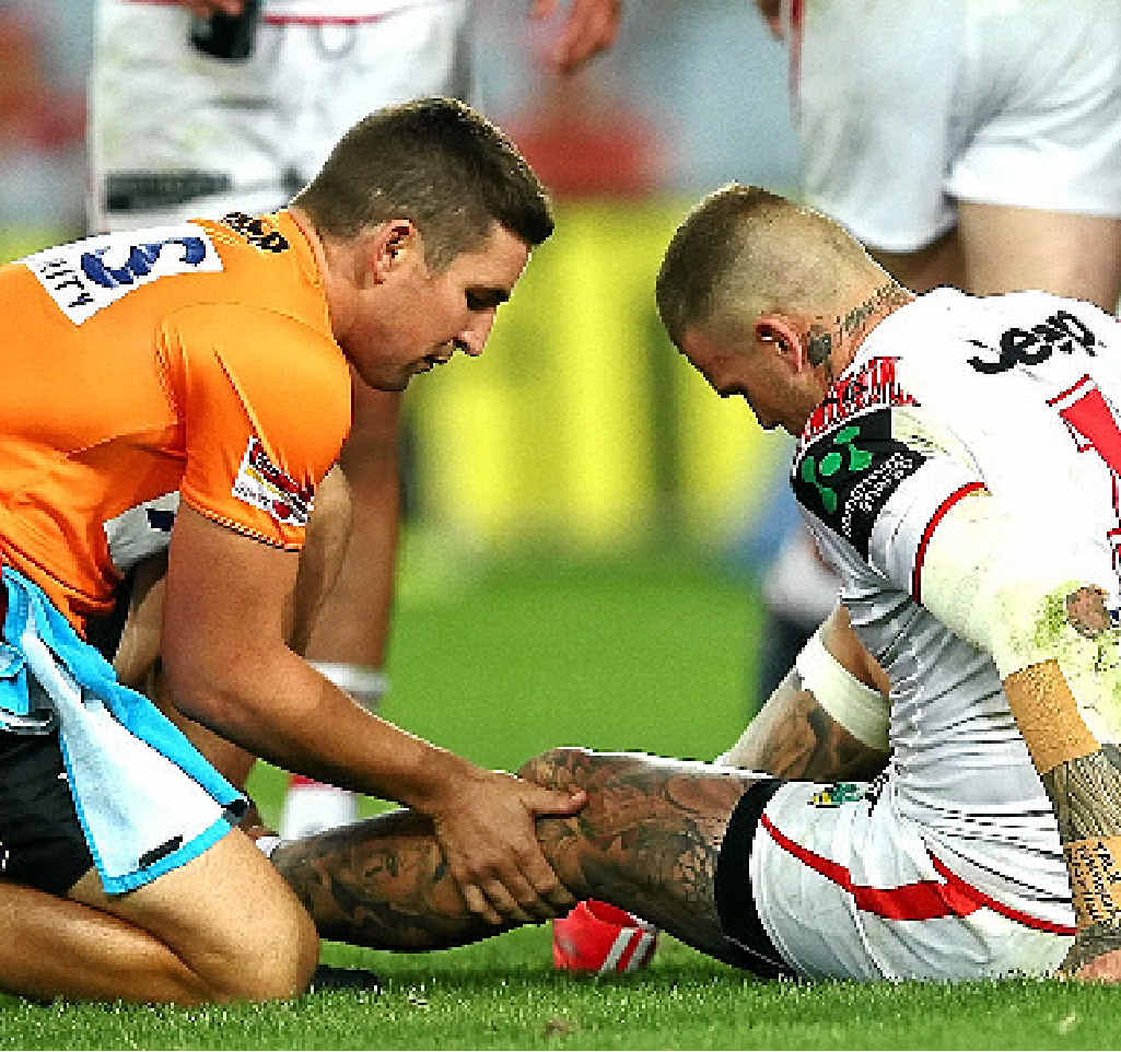 CHECKED OUT: Josh Dugan is treated during the Charity Shield match.