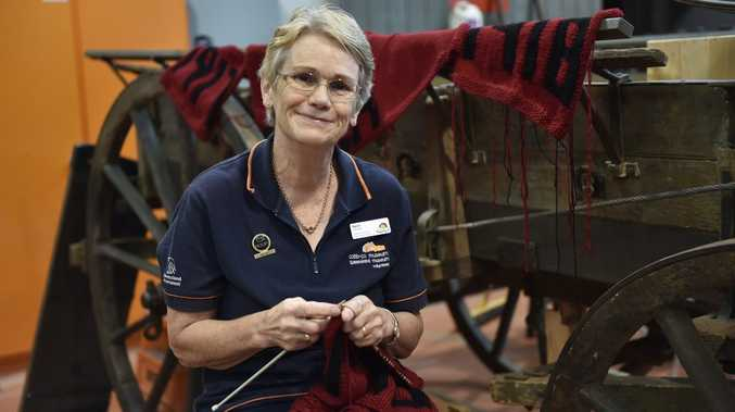 Cobb + Co Museum are hoping keen knitters will come forward and assist them create a fifty metre timeline as part of the WW1 centenary exhibition. Karen Mann, who works as a volunteer at the Museum is busy creating panels.